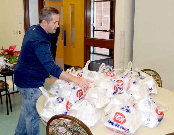 Dan Holste of Effingham counts out meals to be delivered on Christmas Day for the Effingham County FISH Human Services Annual Christmas Day Dinner held at the Sacred Heart Parish Center in Effingham. Charles Mills photo