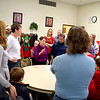 Effingham County FISH Human Services Co-President Susan Elke, center in purple, talks to delivery volunteers before giving out assignments Christmas morning in the Sacred Heart Parish Center for the FISH Annual Christmas Day Dinner. Charles Mills photo
