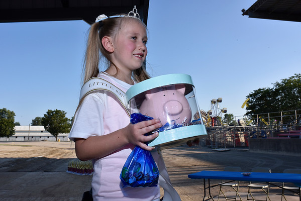 Alaina Miller, 7-year-old daughter of Justin and Teresa Miller of Effingham, was crowned 2017 Little Miss Pigtail with a pigtail length of 23 ½ inches long at the Effingham County Fairgrounds on Tuesday night. Charles Mills photo
