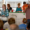 Allyssa Boergen shows her grand champion rabbits during the 4H Auction.<br /> Chet Piotrowski Jr. photo/Piotrowski Studios