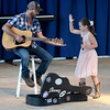 "Emmerson Hanson fives her father, Randy, after performing ""Jack Rabbit"" at the 2017 Effingham County Fair Talent Show.<br /> Chet Piotrowski Jr. photo/Piotrowski Studios"