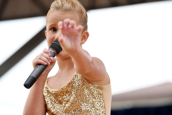"Kennedi Schultz makes a clawing motion while performing Survivor's ""Eye of the Tiger"" Sunday evening in the junior division of the 2017 Effingham County Fair Talent Show.<br /> Chet Piotrowski Jr. photo/Piotrowski Studios"