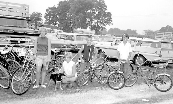 Bicycles and dogs were judged for the first time in the history of the 4-H competition at the Effingham County fair in 1967, picture from left to right, Sharon McVicar of Dieterich, who judges said had an almost perfect performance; Donna Pfenninger and her dog project which took a blue ribbon; Tim Laue, red ribbon for bicycle and Patsy Laue who received a blue ribbon. A State Trooper judged the bicycle projects. EDN file photo
