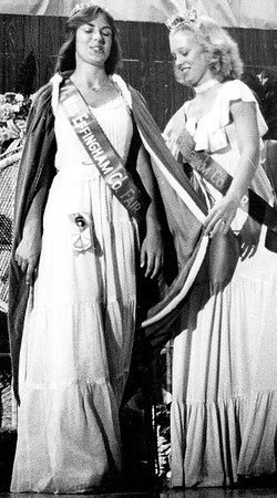 Carol DeeAnn (Moore) Bauguss, left, is all smiles as she is fitted with the royal robe with assistance of retiring queen Julie (Gnuse) Tappendorf after being chosen Miss Effingham County Fair in 1979. EDN file photo