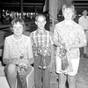 Effingham County Fair 1967 4-H Sheep winners are pictured from left to right, Amy Hogge who showed the champion Hampshire entry, Keith Wendte champion market lamb and showman; and Ellen Hogge, champion Suffolk entry, reserve market lamb and reserve champion showman. EDN file photo