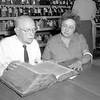 Jacob Wagemann, left is shown as he translates from a German Bible entered into the Antique Division at the Effingham County Fair in 1965. He is pictured with his daughter Mrs. Arthur Grobengieser of Altamont. EDN file photo
