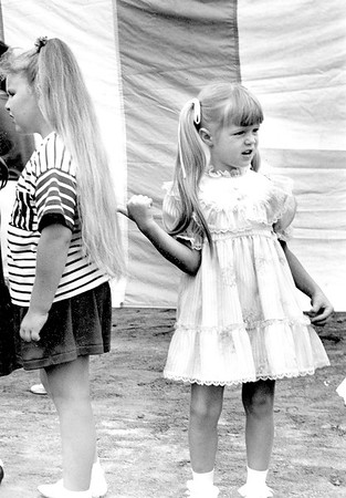 Shannon Kramer, one of the contestants in the Little Miss Pigtail Contest during the Effingham County Fair in 1991, points at the pitgtails of Amber Kinkelaar who went on to win the contest. Amber's pigtails were 26 ½ inches long. EDN file photo