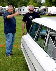Superintendent of the 9th Annual Effingham County Fair Car Show, John Becker, left and Kent Stuckey, left, are judging an entry in Saturday's car show held on the Effingham County Fairgrounds. Additional car show judges were Wade Stuckey, Will Zumwalt and Pastor Jim Wright. Charles Mills photo