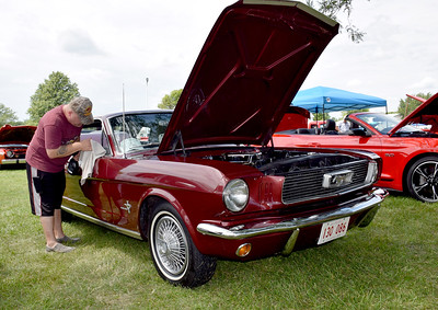 Dale Abbott of Mt. Zion keeps his 1966 Ford Mustang Spirit 200 spotless at the Effingham County Fair Car Show on Saturday. Charles Mills photo