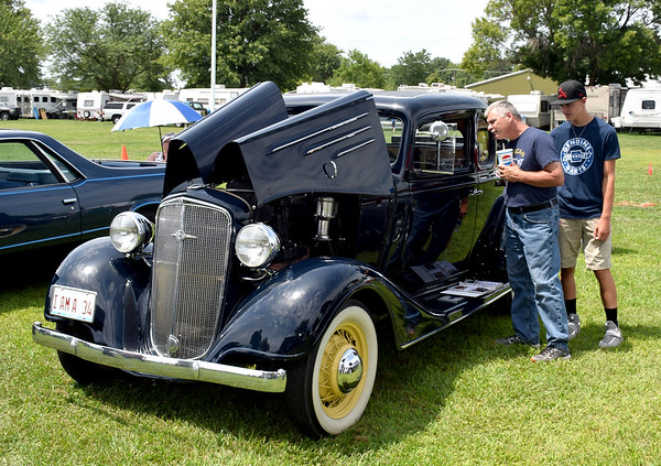 Brian Boerngen, left, and Nathan Boerngen, right, both of Mason look at the interior of a 1934 Chevrolet owned by Jack and Marilyn Rockow of Effingham. Charles Mills photo
