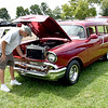 Bob Heckert of St. Elmo checks his 1957 Chevy 150 two door car show entry at the Effingham County Fair on Saturday. Heckert says there were only 292 two-door units like his made in 1957. Charles Mills photo