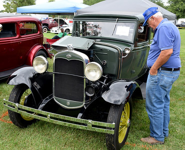 Effingham County Fair President Phil Hartke inspects at a 1931 Ford A-Town Sedan Saturday afternoon at the 9th Annual Effingham County Fair Car Show. Hartke was choosing the Effingham County Fair President's Choice award. Charles Mills photo