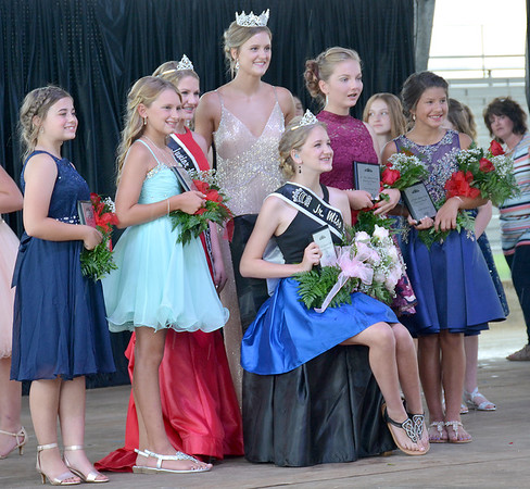 Effingham County Junior Miss 2020 Queen Joni Beckman, seated, beams just after she is crowned by retired 2019 Junior Miss Queen Hali Kreke and retired 2019 Miss Effingham County Queen Shayna Phillips. Flanking Beckman are, from left to right, third runner up Presley Siebert, second runner up Melia Wendling, Kreke, Phillips, first runner up Korina Hecht and fourth runner up Kyndal Fearday.