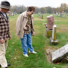 Paul Field and Eleanor Bounds inspect a grave marker in the Edgewood Cemetery Thursday morning during the Effingham County Genealogical and Historical Society Cemetery Hop. Charles Mills photo