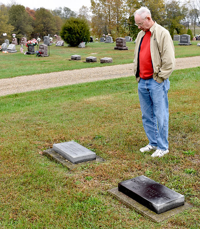 Jerry Katz of Effingham found the graves of his aunt and uncle in Edgewood Cemetery during the Effingham County Genealogical and Historical Society Cemetery Hop on Thursday morning. Charles Mills photo