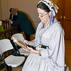 Dance Mistress Deborah H. Hyland of St. Louis studies her book of dance movements before the Civil War Grand Ball Saturday night held in the Effingham County Museum.  Charles Mills photo