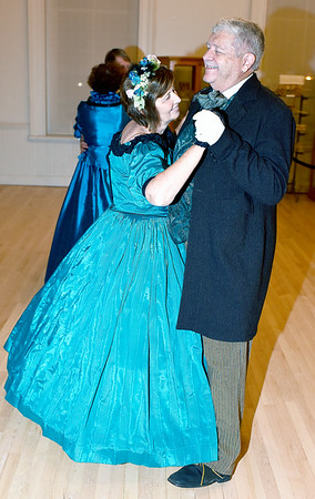 Kathy Wormhoudt, left and her husband, Dan Wormhoudt, right, dance to a waltz during the Civil War Era Grand Ball Saturday night held at the Effingham County Museum in downtown Effingham. Charles Mills photo
