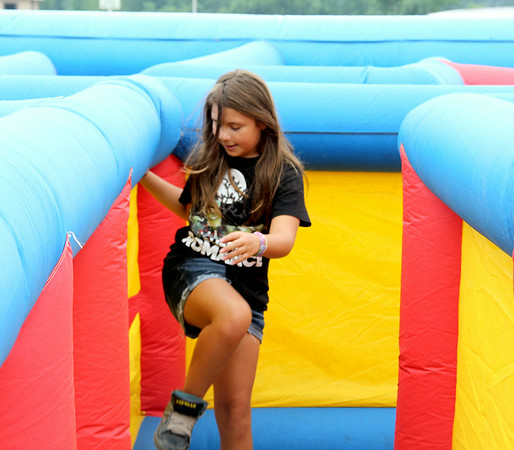 Lilly Day climbs threw the walls of an inflatable maze at Effingham FreedomFest Saturday.<br /> Tony Huffman photo