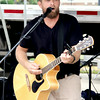 Joe Miller, lead singer for Jezreel Sun, sings at Effingham FreedomFest Saturday afternoon.