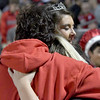Kayla Cordes and her daughter, Kaitlin Cordes, hug Kourtney Cordes after she was crowned the 2017 Effingham High School Homecoming queen Friday evening during half-time of the Hearts match-up against Mahomet-Seymour. Cordes' father died from cancer earlier this month. Lucas Vasquez was named homecoming king. <br /> Chet Piotrowski Jr. photo/Piotrowski Studios