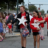 Effingham Junior High School Student Council members Meredith Schaefer, Sawyer Althhoff, and Tori Budde throw candy to the crowd along Jefferson Ave. in downtown Effingham during the Homecoming parade Wednesday evening.<br /> Chet Piotrowski Jr. photo/Piotrowski Studios