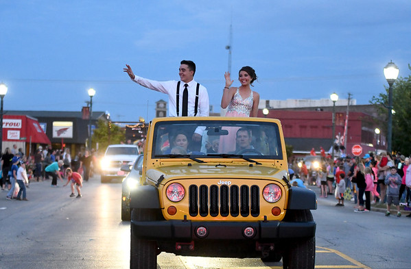 Effingham High School king and queen candidates Lucas Vasquez and Kourtney Cordes wave to the crowd on Jefferson Ave. in downtown Effingham during the Homecoming parade Wednesday evening.<br /> Chet Piotrowski Jr. photo/Piotrowski Studios