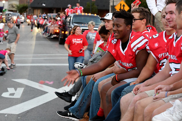Effingham's Matthew Robinson (50) throws candy to the crowd along Jefferson Ave. in downtown Effingham during the Homecoming parade Wednesday evening.<br /> Chet Piotrowski Jr. photo/Piotrowski Studios