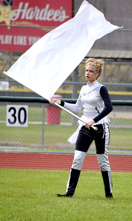 Newton Community High School Color Guard Member Sarah Blecha performs a flag routine during the Effingham Marching Hearts Invitational band contest on Saturday at Effingham High School. Charles Mills photo