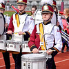 Tenor Drummer Tony Fanelli, left, and Snare Drummer Gavin Melton march off the field after their performance with the LeRoy High School Marching Panthers band during the Effingham Marching Hearts Invitational band contest. Charles Mills photo