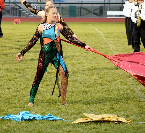 Color Guard Member Autumn Rinkel performs during an exhibition performance of the Effingham Hearts Red Regiment Band on Saturday during the Effingham Marching Hearts Invitational band contest. Charles Mills photo