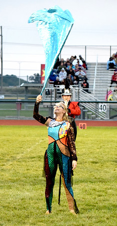 Effingham Hearts Red Regiment color guard member Katie Rush twirls her flag during a special band exhibition Saturday at Effingham High School Klosterman Field. Charles Mills photo