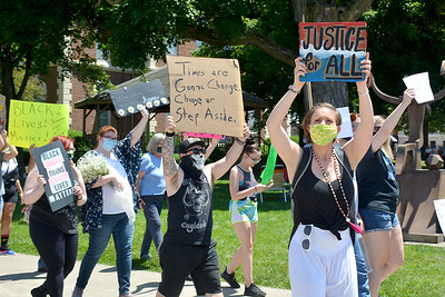 Demonstrators march around the Effingham Cultural Center and Museum lawn during the Effingham Social Justice Group's rally Saturday.