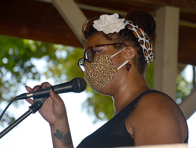 Skylar Rogers of Altamont sings in under the gazebo on the Effingham County Cultural Center and Museum lawn during the Effingham Social Justice Group's peaceful rally Saturday.