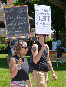 Demonstrators call for social justice and reform during a peaceful rally put on by the Effingham Social Justice Group Saturday.