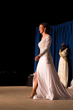 Whitney Donaldson walks the stage Tuesday during the Evening Gown Competition at the Effingham County Fair Queen Pageant. | Photo by Cassie Porter