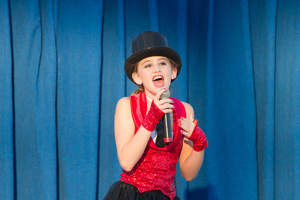 "Abby Cothran of Teutopolis entertains the crowd Saturday during the Effingham County Fair Talent Show. Cothran Sang ""Born To Entertain"" in the Junior Division of the show. 