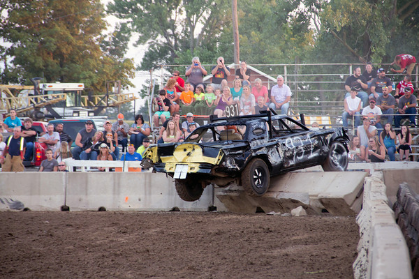Vic Robertson of Watson and his 1978 Lincoln went on a wild ride as he was pushed onto the retaining wall where he and his car remained until the end of heat 2 at the derby Saturday night at the Effingham County Fair.