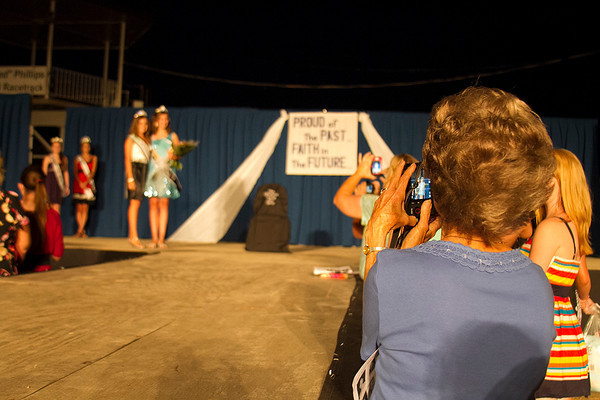 Audience members of the Effingham County Fair Junior Miss competition line up Saturday to take photos of the winners after the pageant. | Photo by Cassie Porter
