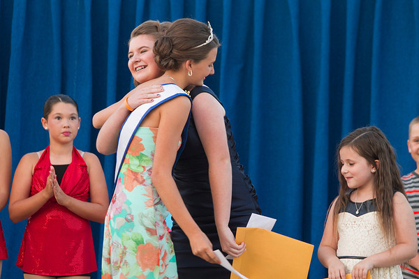 Lauren Siemer, 14, of Teutopolis hugs the 2012 Junior Miss Saturday after learning that she received first place in the Junior Division of the Effingham County Fair Talent Show.