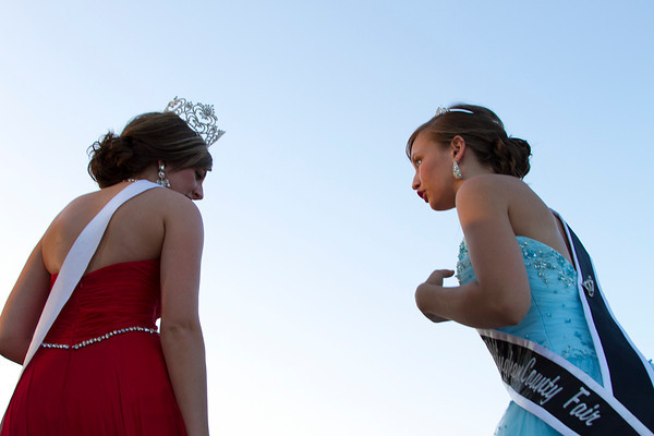 Gina Thoele, Miss Effingham County Fair 2012, and Libby Feldhake, Junior Miss Effingham County Fair 2013, talk on stage during the Effingham County Fair Queen Pageant Tuesday. | Photo by Cassie Porter