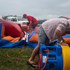 Tonns of Fun workers deflate the inflatables at the Effingham County Fair Friday. They were temporarily taken down due to heavy rainfall, but were back up within an hour. | Photo by Alexa Rogals