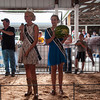 2013 Effingham County Fair Queen, Breeanna Strauch, left, and Effingham County Jr. Miss Libby Feldhake auction off a watermelon Wednesday during the 4-H Auction at the Effingham County Fair in Altamont. | Photo by Alexa Rogals