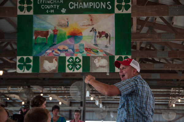 Trent Schmid, of Tuetopolis, keeps track of bidders Wednesday during the 4-H Auction at the Effingham County Fair in Altamont. Schmid was one of several others who helped with bidding and announcements during the auction. | Photo by Alexa Rogals