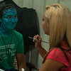 A fair-goer gets a makeover at a face-painting table during the first day of the Effingham County Fair. | Photo by Alexa Rogals