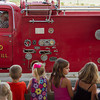 Children stand up front for the Effingham County Fair Twilight Parade as it passes through the Grand Stand.   Photo by Cassie Porter