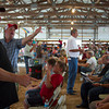 Mark Stoneburner, left, of Beecher City and Trent Schmid of Teutopolis keep an eye on bidders during the 4-H Auction at the Effingham County Fair in Altamont. The auction had a variety of different animals, from rabbits to cows. | Photo by Cassie Porter