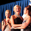 Megan Brandt hugs a fellow contestant Tuesday at the Effingham County Fair Queen Pageant after hearing the results, which would crown her as the 2013 Queen. | Photo by Cassie Porter