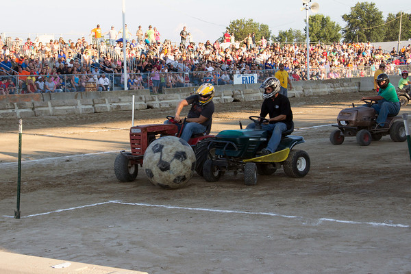 A fierce game of lawnmower soccer broke out at the Effingham County Fair Saturday night. The game, which was put on by Grandstands Attractions, consists of two teams competing to push a soccer ball into opposing goals.