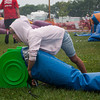 Madison Tonn, 7, helps take down one of the inflatable slides at the Effingham County Fair. The inflatables, provided by Tonns of Fun, were temporarily taken down due to heavy rainfall early Friday evening. The inflatables were back up within an hour. | Photo by Alexa Rogals