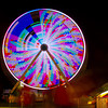 The Ferris Wheel at the Effingham County Fair lights up the Midway Monday night as fair-goers walk through. | Photo by Cassie Porter